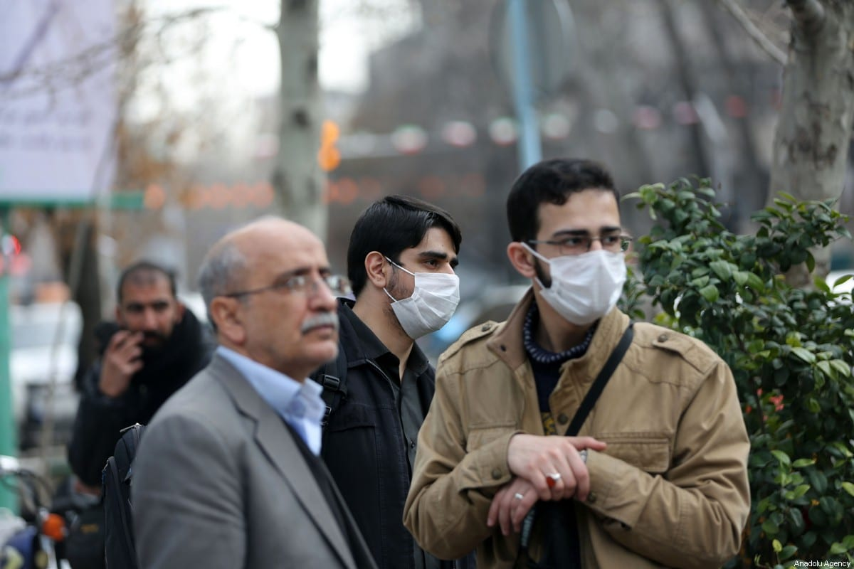 People wear masks after deaths and new confirmed cases revealed from the coronavirus in Tehran, Iran on 21 February 2020 [Fatemeh Bahrami/Anadolu Agency]