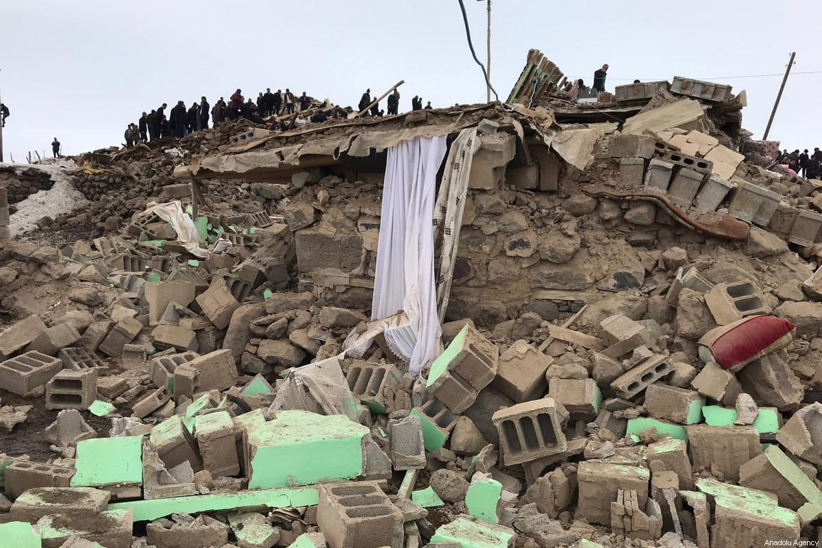 Debris of collapsed buildings after a magnitude-5.9 earthquake struck near the border with Iran, in Ozpinar neighbourhood of Baskale district in eastern Van province of Turkey on February 23, 2020 [Necat Hazar / Anadolu Agency]
