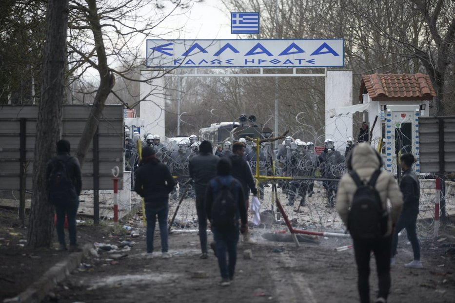 Greek border police throw tear gas canisters and stun grenades to send away irregular migrants who try to enter Greek side at Turkey's border with Greece in Edirne, Turkey on 29 February 2020. [Gökhan Balcı - Anadolu Agency]