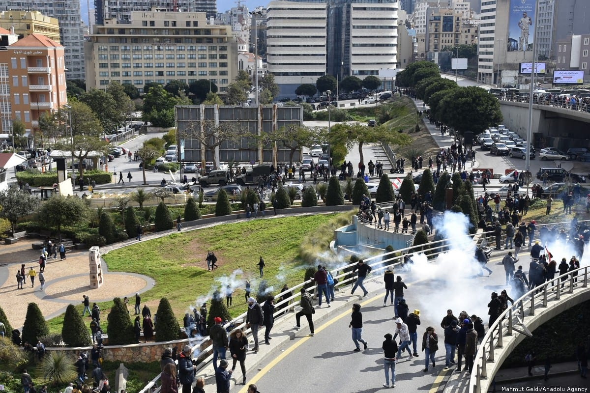 Lebanese security forces clash with protesters during a protest held before a session at a parliament for a vote of confidence to new government of Hassan Diab on February 11, 2020 in Beirut, Lebanon [Mahmut Geldi/ Anadolu Agency]