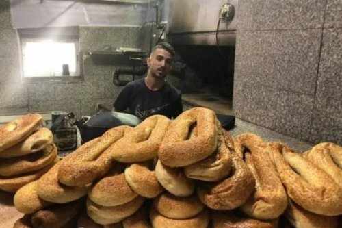 Naser Abu Snaina was arrested by Israeli occupation forces in Jerusalem and his familys bakery was shut down on 19 February 2020 [Twitter]