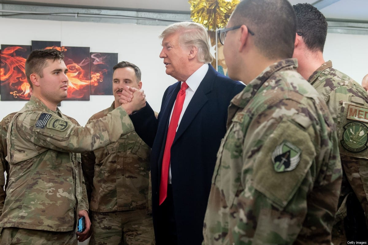US President Donald Trump greets members of the US military during an unannounced trip to Al-Asad Air Base in Iraq on 26 December 2018 [SAUL LOEB/AFP/Getty Image]