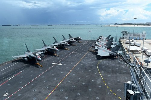 France's fighter jets Rafale are seen parked on the flight deck of the French aircraft carrier Charles de Gaulle during a media tour at Changi Naval Base in Singapore on May 28, 2019 [ROSLAN RAHMAN/AFP via Getty Images]