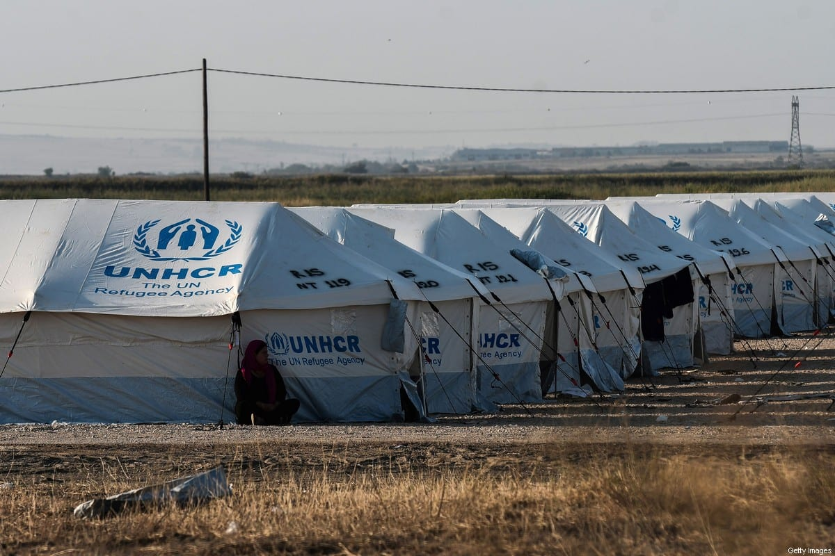 A refugee woman sits next to a tent in Nea Kavala camp, near the city of Kilkis, northern Greece, on September 3, 2019. [SAKIS MITROLIDIS/AFP via Getty Images]