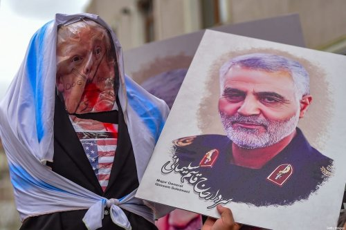 Protesters hold an effigy of US President Donald Trump and a picture of Iranian commander Qasem Soleimani, during a demonstration outside the US consulate in Istanbul, on January 5, 2020 [YASIN AKGUL/AFP via Getty Images]