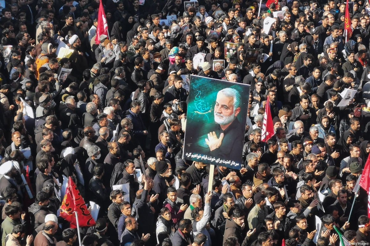 Iranian mourners gather for the burial of top general Qasem Soleimani in his hometown Kerman on 7 January 2020 [ATTA KENARE/AFP/Getty Images]