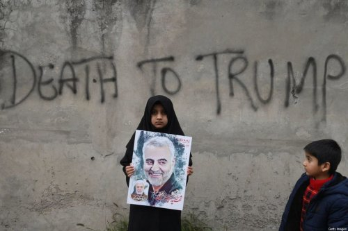 TOPSHOT - A Shiite Muslim girl holds a poster of Iranian commander Qasem Soleimani as she takes part in a anti-US protest against the killing of top Iranian commander Qasem Soleimani in Iraq, in Lahore on January 12, 2020. - Iran's Revolutionary Guards chief briefed parliament on January 12 over the killing of a top general by the US, Tehran's retaliation and the subsequent downing of an airliner, ISNA news agency said. (Photo by ARIF ALI / AFP) (Photo by ARIF ALI/AFP via Getty Images)