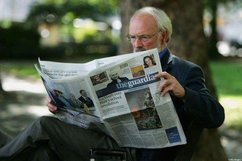 In this photo illustration a man reads a copy of The Guardian newspaper on 12 September, 2005 in London, England [Scott Barbour/Getty Images]