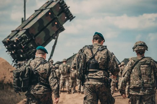 Soldiers walk to the site of the new Patriot missile system on 4 June 2018 [Michigan Army National Guard photo by Spc. Aaron Good/Released]