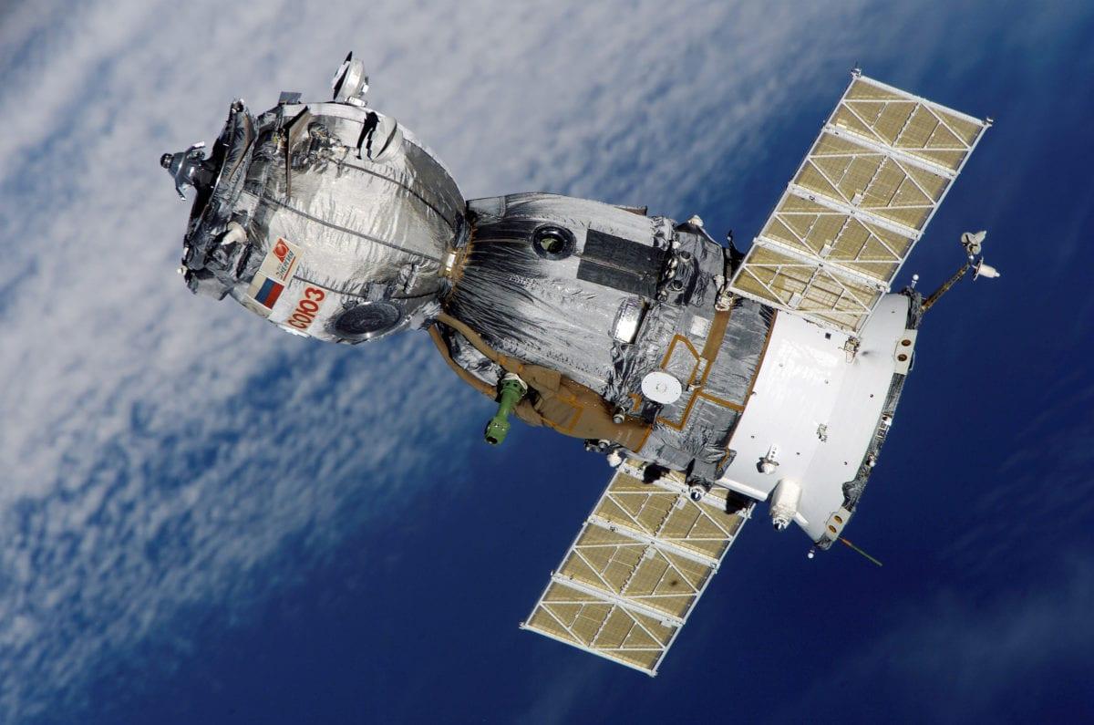 Satellite orbiting Earth [ThegreenJ/Wikipedia]