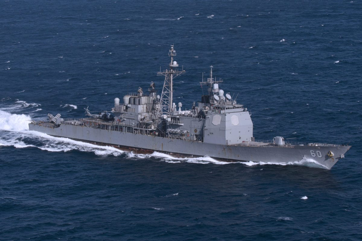 The U.S. Navy guided-missile cruiser USS Normandy (CG-60) underway in the Atlantic Ocean on 16 February 2018 as part of the Harry S. Truman Carrier Strike Group (HSTCSG) while conducting its composite training unit exercise [Scott Swofford / US Navy]