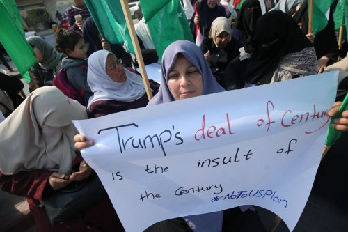 Women in Gaza come together to protest against Trump's 'peace deal' on 5 February 2020 [Mohammad Asad/Middle East Monitor]