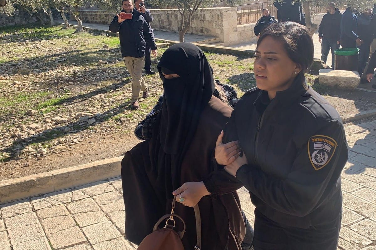 Israeli security forces take Naide Salah, who is the sister of 1948 Palestine Islamic Movement Leader Raed Salah, into custody alongside 4 Palestinian women at Masjid al-Aqsa in Jerusalem on January 28, 2020 [Jerusalem Islamic Waqf/Handout - Anadolu Agency]