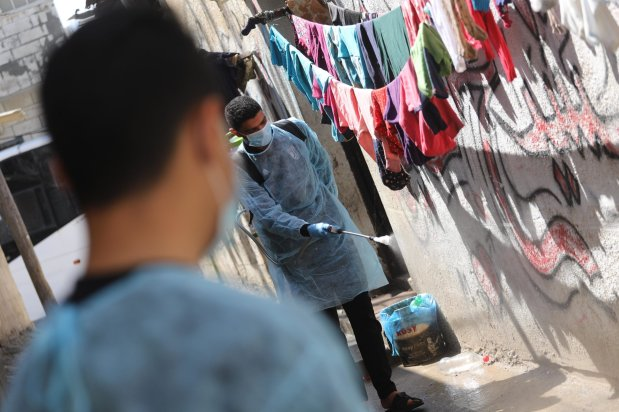 Voluntary campaign to disinfect houses in refugee camps in the Gaza Strip to as a precautionary step against the coronavirus o 16 March 2020 in Gaza