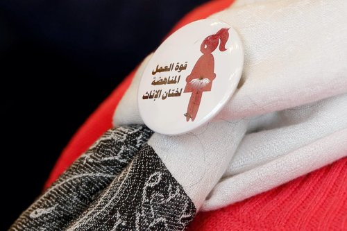 """A badge reads """"The power of labor aginst FGM"""" is seen on a volunteer during a conference on International Day of Zero Tolerance for Female Genital Mutilation (FGM) in Cairo, Egypt on 6 February 2018. [REUTERS/Amr Abdallah Dalsh]"""
