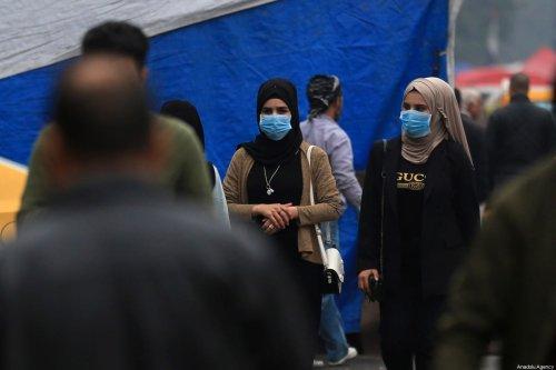 Women wear masks as a precaution against coronavirus on 25 February 2020 [Murtadha Al-Sudani/Anadolu Agency]