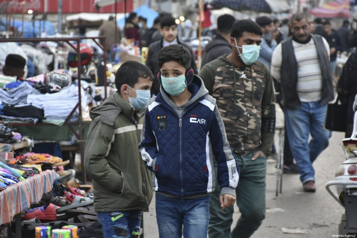 Young boys wear medical masks as a precaution to protect themselves from coronavirus in Kirkuk, Iraq on February 25, 2020. According to the latest reports 4 people infected with Coronavirus in Kirkuk, north of Baghdad [Ali Makram Ghareeb - Anadolu Agency]