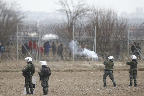 Greek security forces intervene in asylum seekers, who attempt to cross the barbed fence at the closed-off Greek-Turkish border, in Kastanies, Greece on 4 March 2020 [DIMITRIS TOSIDIS - Anadolu Agency]
