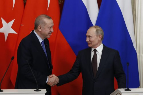 President of Turkey Recep Tayyip Erdogan (L) and President of Russia Vladimir Putin (R) shake hands at the end of a joint news conference following an inter-delegation meeting at Kremlin Palace in Moscow, Russia on 5 March 2020. [Sefa Karacan - Anadolu Agency]