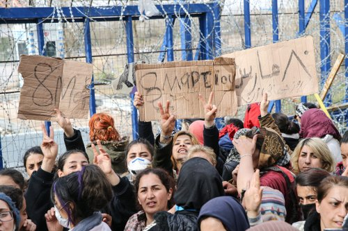 Women Asylum Seekers, waiting at Turkey's Pazarkule border crossing to reach Europe, stage a demonstration at the buffer zone demanding to open the gate during 'International Women's Day', on March 08, 2020 in Turkey's Edirne. [Elif Öztürk - Anadolu Agency]