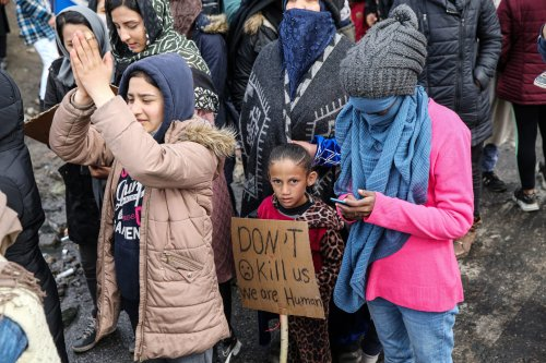 Women Asylum Seekers, waiting at Turkey's Pazarkule border crossing to reach Europe, stage a demonstration at the buffer zone demanding to open the gate during 'International Women's Day', on March 08, 2020 in Turkey's Edirne [Elif Öztürk - Anadolu Agency]