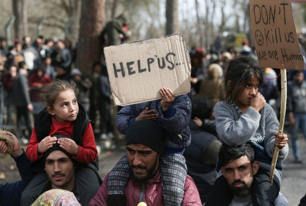 Women Asylum Seekers, waiting at Turkey's Pazarkule border crossing to reach Europe, stage a demonstration at the buffer zone demanding to open the gate during 'International Women's Day', on March 08, 2020 in Turkey's Edirne. [Elif Öztürk - Anadolu Agency]