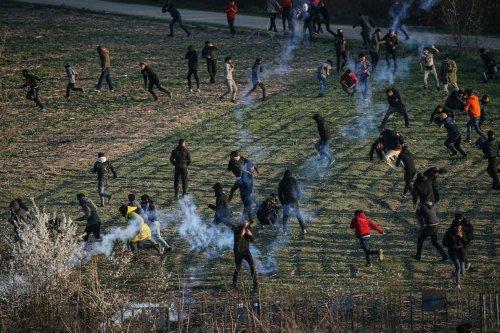 Greek security forces use tear gas to disperse asylum seekers in the region between the Kastanies and the Pazarkule border gates on 11 March 2020. [Elif Öztürk - Anadolu Agency]
