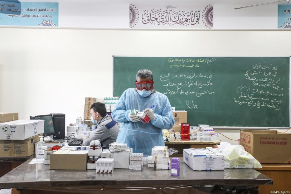 Healthcare workers are seen at a UNRWA school which has been converted into a clinic for patients as a precaution against the coronavirus (COVID-19) in Gaza City, Gaza on 18 March 2020 [Ali Jadallah/Anadolu Agency]