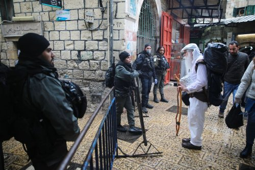 Israeli forces stand guard at checkpoints within the coronavirus (Covid-19) pandemic precautions ahead of the Friday Prayer in Jerusalem on 20 March 2020 [Mostafa Alkharouf/Anadolu Agency]