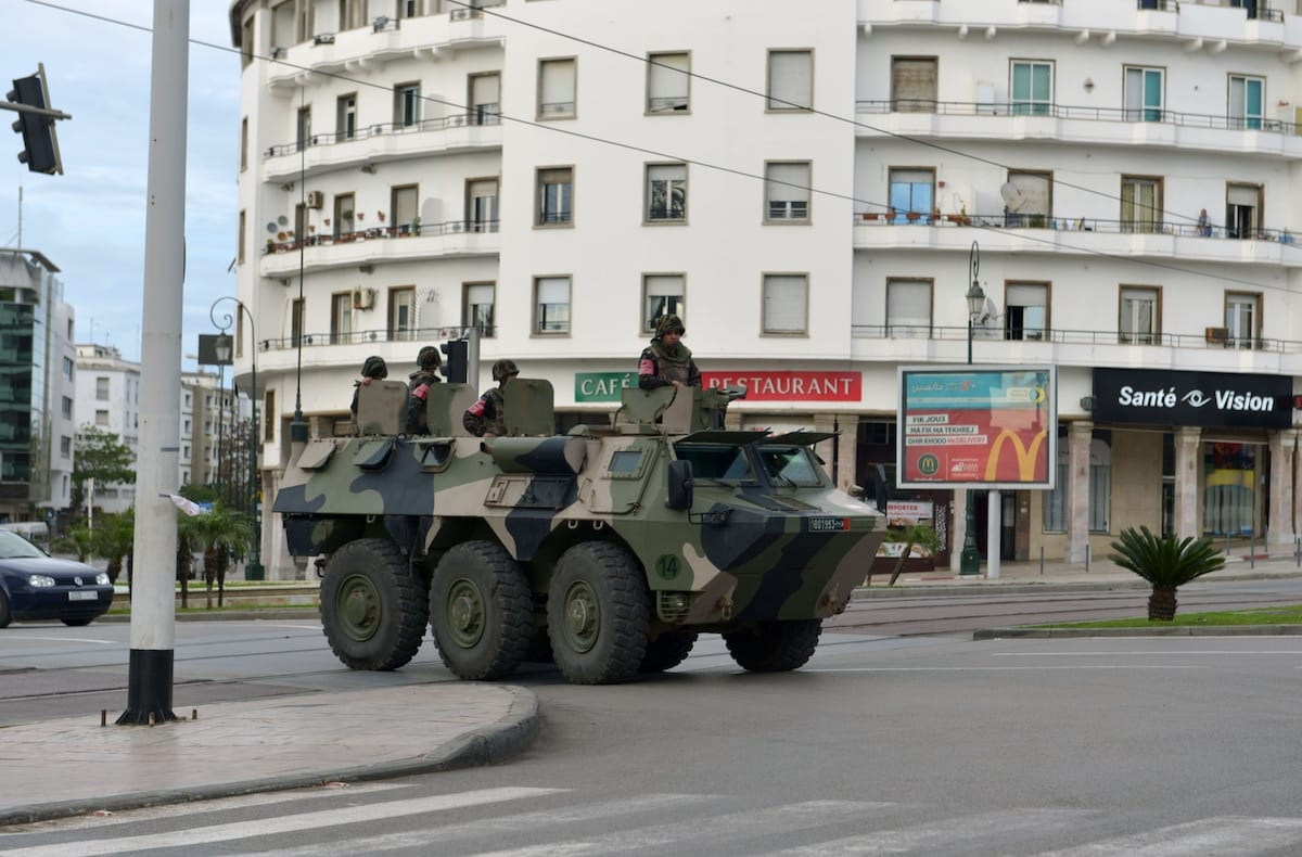 Security forces order to stay home to people after state of emergency declaration as a precaution against new type of coronavirus (COVID-19) in Rabat, Morocco on 21 March 2020. [Jalal Morchidi - Anadolu Agency]