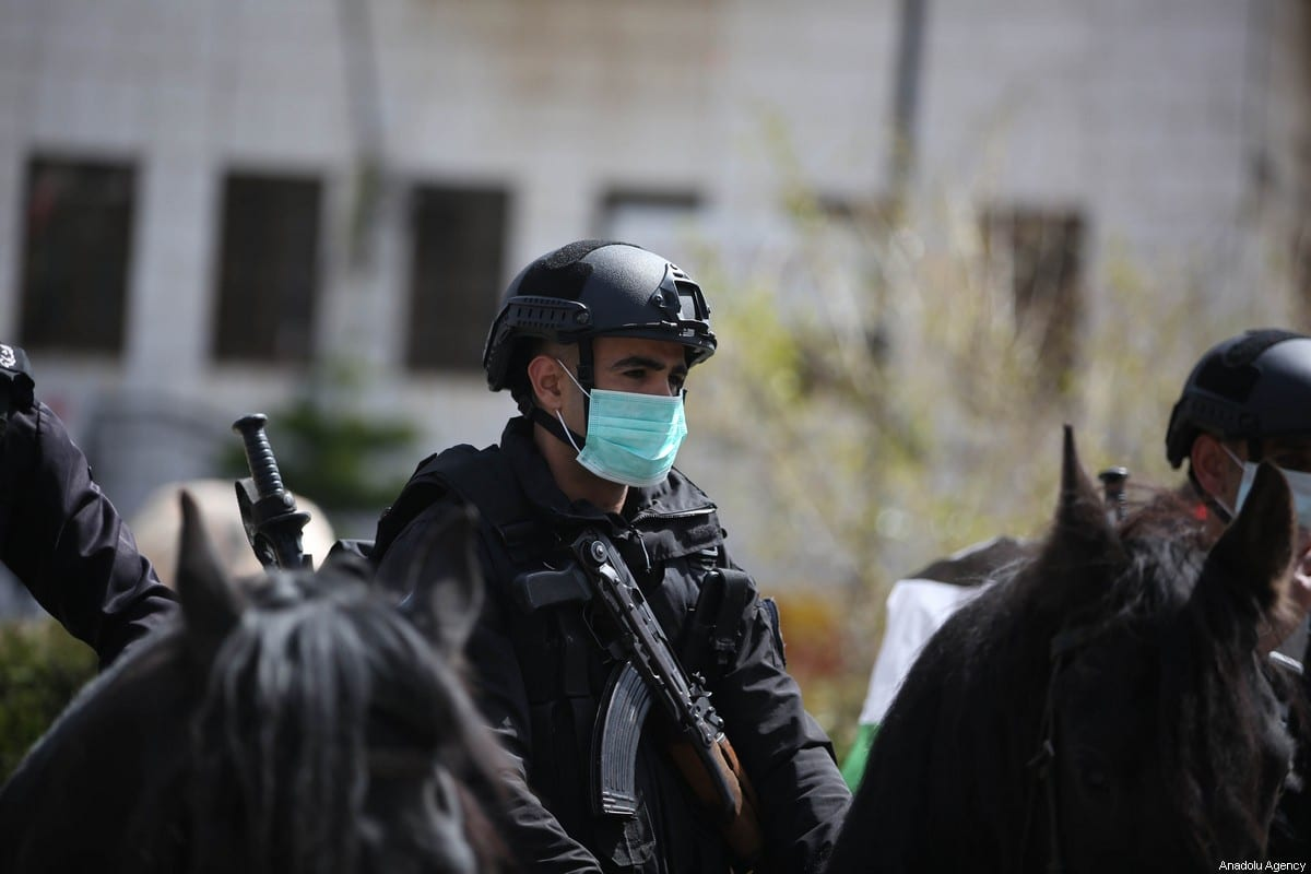 Police officers take security measures at streets after a curfew was announced by authorities as a measure against coronavirus (COVID-19), in Ramallah, West Bank on March 23, 2020 [Issam Rimawi/Anadolu Agency]