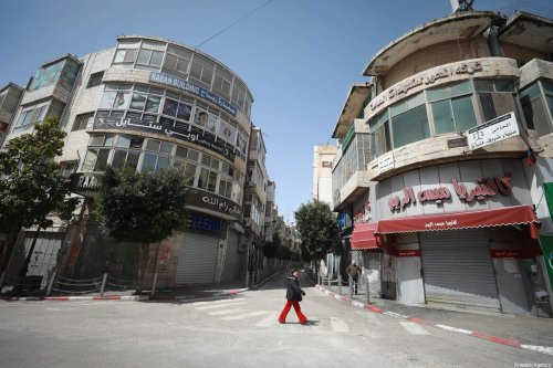 Empty streets and closed shops are seen after a curfew was announced by authorities as a measure against coronavirus (COVID-19), in Ramallah, West Bank on March 23, 2020 [Issam Rimawi / Anadolu Agency]