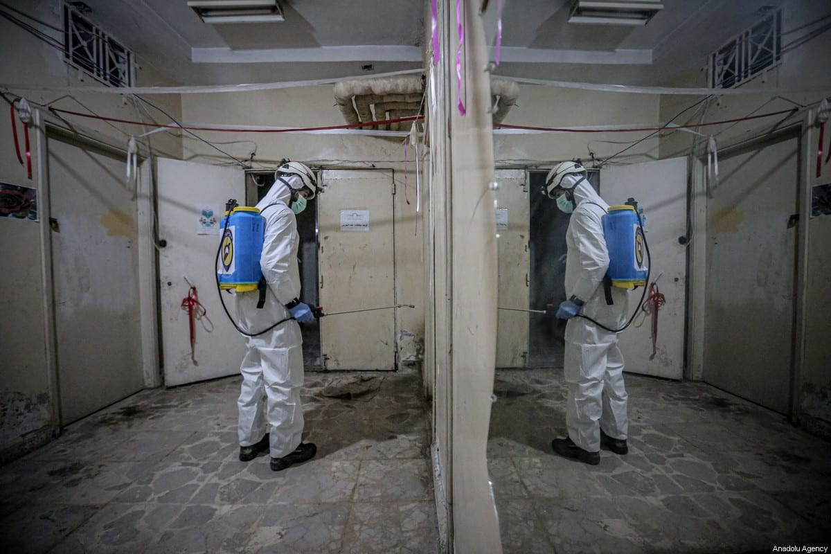 Members of the Syrian Civil Defence (White Helmets) disinfect public places as a preventive measure against coronavirus (Covid-19) pandemic in Idlib, Syria on March 24, 2020 [Muhammed Said / Anadolu Agency]