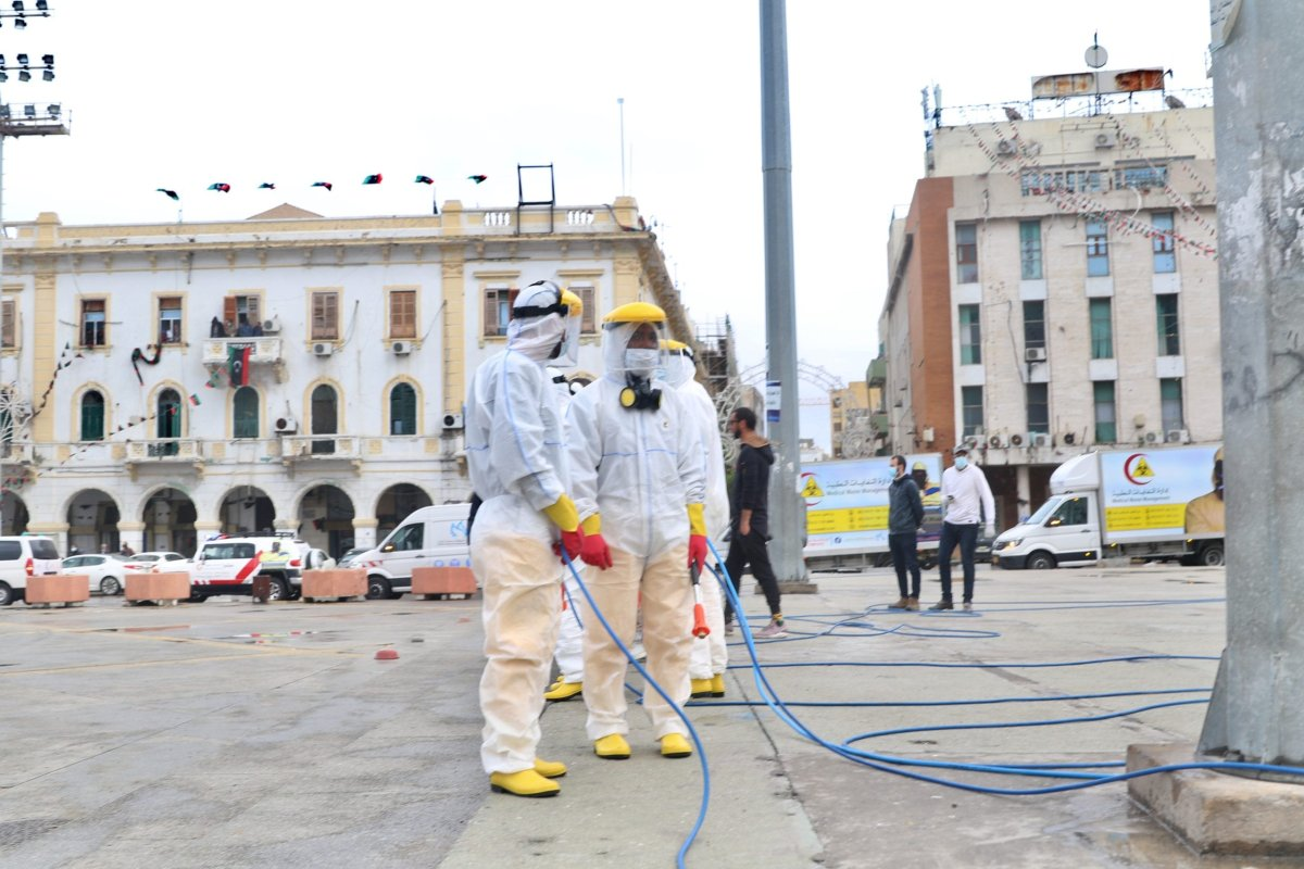 Officials carry out disinfection works within coronavirus (COVID-19) precautions at Martyrs' Square in Tripoli, Libya on March 25, 2020. [Hazem Turkia - Anadolu Agency]