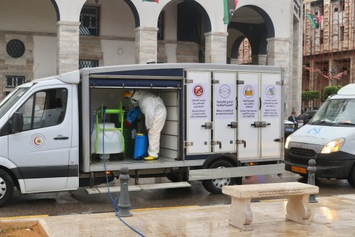 Officials carry out disinfection works within coronavirus (COVID-19) precautions at Martyrs' Square in Tripoli, Libya on 25 March 2020. [Hazem Turkia - Anadolu Agency]
