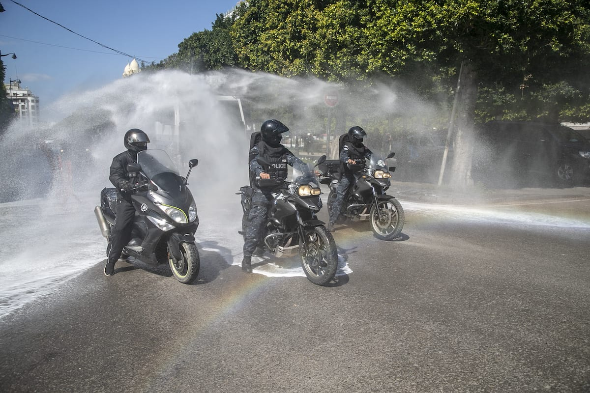 Tunisian riot police officers carry out disinfection works at streets within precautions against coronavirus (COVID-19) in Tunis, Tunisia on March 28, 2020 [Yassine Gaidi / Anadolu Agency]