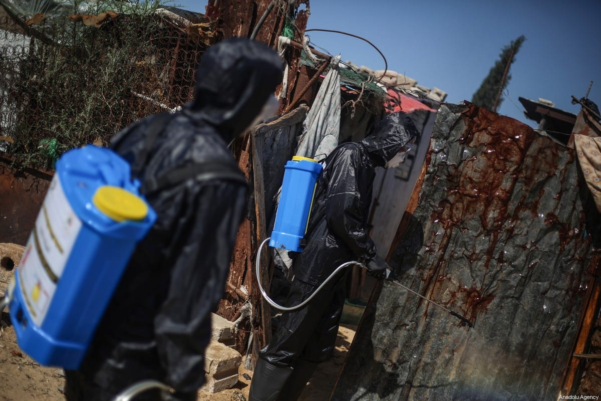 A group of volunteer youth carry out disinfections works at Cold River Camp as part of coronavirus (Covid-19) pandemic precautions, in Khan Yunis, Gaza on March 29, 2020 [Mustafa Hassona - Anadolu Agency]