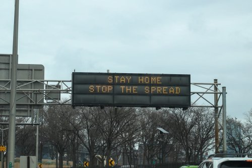 A freeway sign that says 'Stay Home Stop The Spread' is seen in New York, US on 25 March 2020 [Tayfun Coşkun/Anadolu Agency]