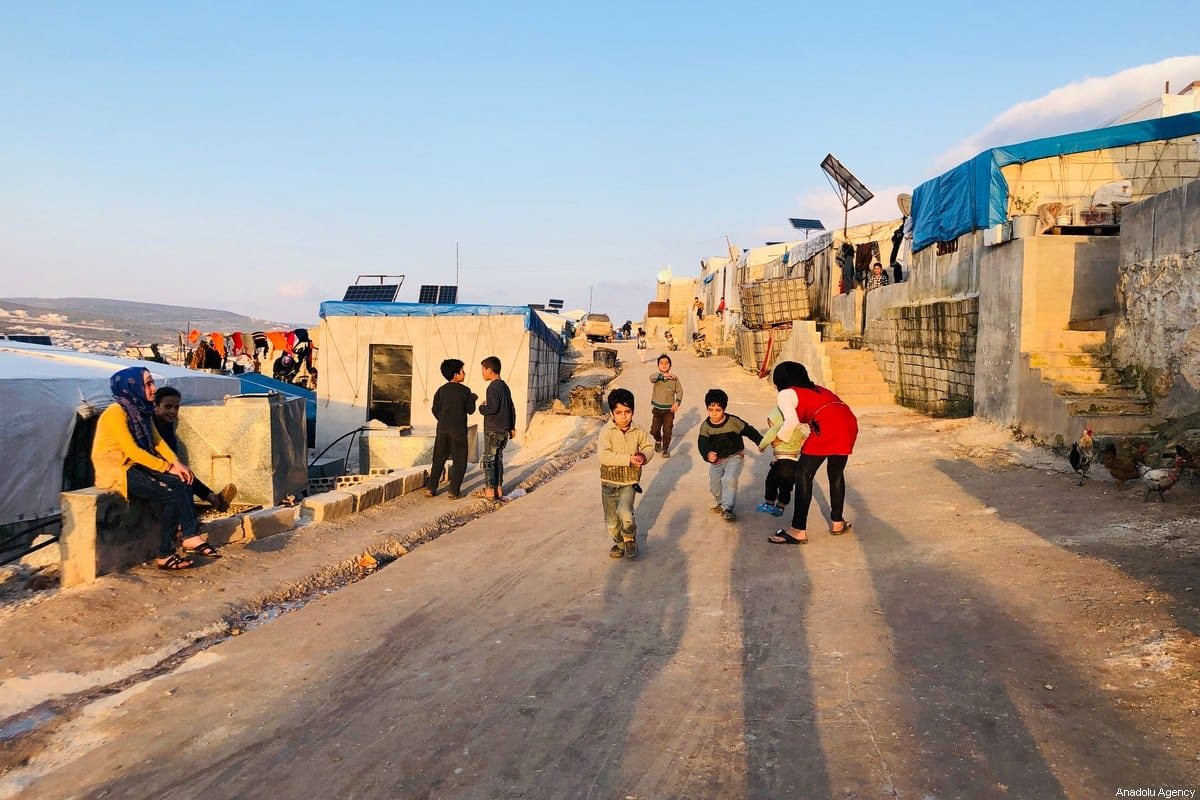 Syrian kids are seen at a makeshift camp at Syria - Turkey border at the North of Idlib 3 years after chemical attack over Khan Shaykhun carried out by Assad Regime in Syria on 2 April 2020. [Muhammed Abdullah - Anadolu Agency]