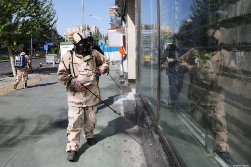 Fire brigade crew and Iran's Basij paramilitary forces, wearing protective suits, carry out disinfection works at streets as part of precautions against the coronavirus (COVID-19) pandemic in Tehran, Iran on April 3, 2020 [Fatemeh Bahrami / Anadolu Agency]