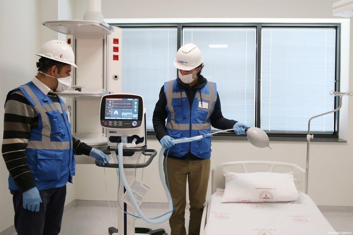 Officials check the ventilators allocated for early treatment of coronavirus (COVID-19) on 4 April 2020 [Elif Öztürk/Anadolu Agency]