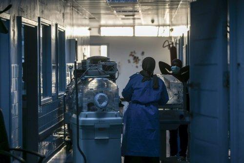 Doctors help coronavirus patients after the rockets fired by Haftar hit the Al-Hadra Hospital in Tripoli, Libya on 5 April 2020 [Amru Salahuddien/Anadolu Agency]
