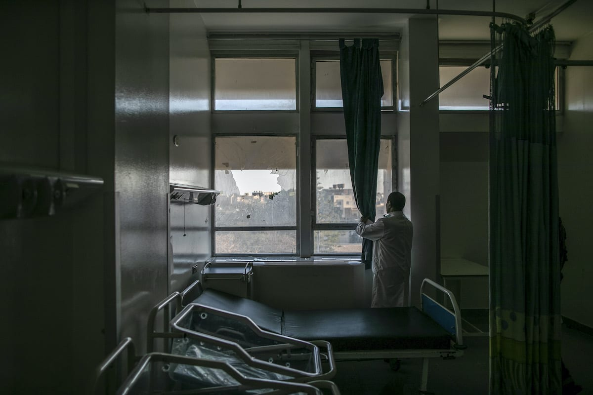 A man inspects the hospital room after Haftar forces' rocket attacks hit the al-Hadra Hospital, which has many patients with chronic illnesses and especially coronavirus (COVID-19) , in Tripoli, Libya on 5 April 2020. [Amru Salahuddien - Anadolu Agency]