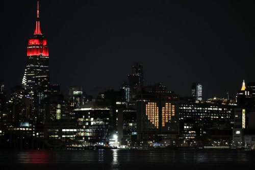 Empire State Building lights up like an ambulance to honor emergency healthcare workers responding to the new type of coronavirus (COVID-19) pandemic in New York City, United States on 7 April 2020. [Tayfun Coşkun - Anadolu Agency]