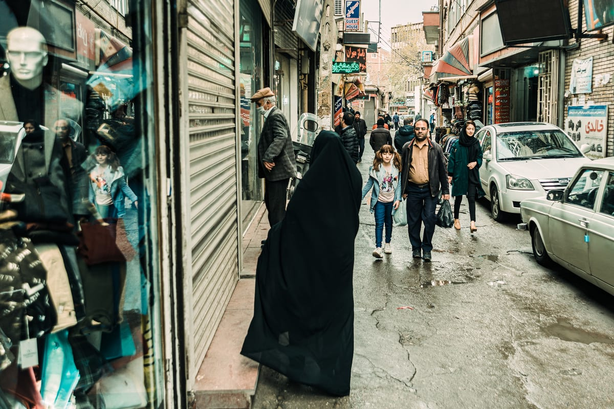 People are seen on a street after Iranian government gradually remove the precautions against the novel coronavirus (Covid-19) pandemic leading shops to re-open in Tabriz, Iran on April 12, 2020. [Stringer - Anadolu Agency]