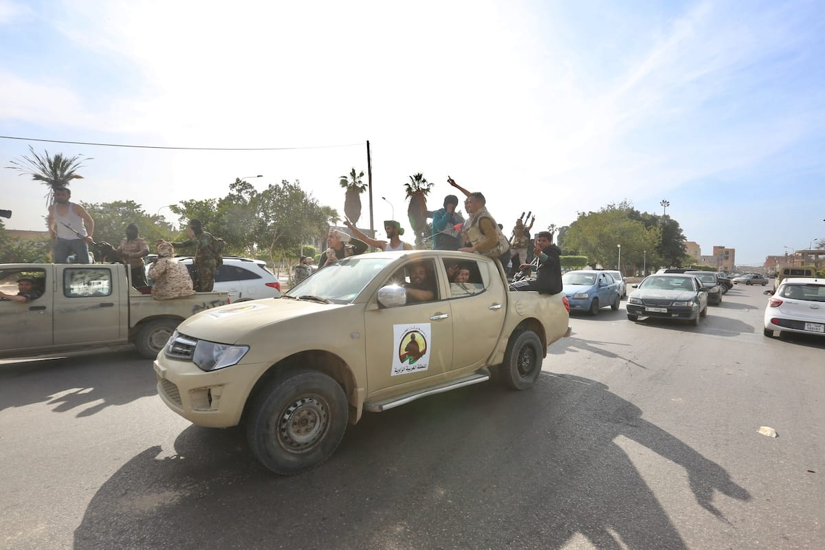 """Libya's Government of National Accord forces celebrate after taking control of Sabratha and its Surman town from Khalifa Haftar's forces within """"Operation Peace Storm"""" in Sabratha, Libya on April 13, 2020 [Hazem Turkia / Anadolu Agency]"""