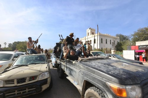 """Libya's Government of National Accord forces celebrate after taking control of Sabratha and its Surman town from warlord Khalifa Haftar's forces within """"Operation Peace Storm"""" in Sabratha, Libya on April 13, 2020 [Hazem Turkia - Anadolu Agency]"""