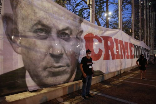 Israelis gather to protest against Prime Minister Benjamin Netanyahu at Rabin Square in Tel Aviv, Israel on 19 April 2020. [Daniel Bar On - Anadolu Agency]