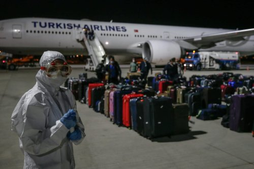 A plane carrying Turkish citizens from Qatar arrives at Adnan Menderes Airport in Izmir, Turkey on 26 April 2020 [Mahmut Serdar Alakuş/Anadolu Agency]