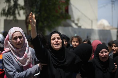 Relatives of Nur Jabir al-Bergushi, 23, who died in Negev prison belonging to Israel, mourn during his funeral ceremony in the Aboud village of Ramallah, West Bank on 27 April 2020. [Issam Rimawi - Anadolu Agency]
